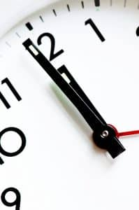 Minute and hour hand at 12 on clock
