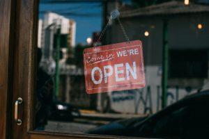 Come in we're open sign on glass door