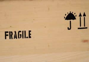 Fragile this side up on side of crate