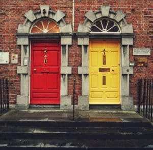 2 coloured entry doors to a building, one red, one yellow