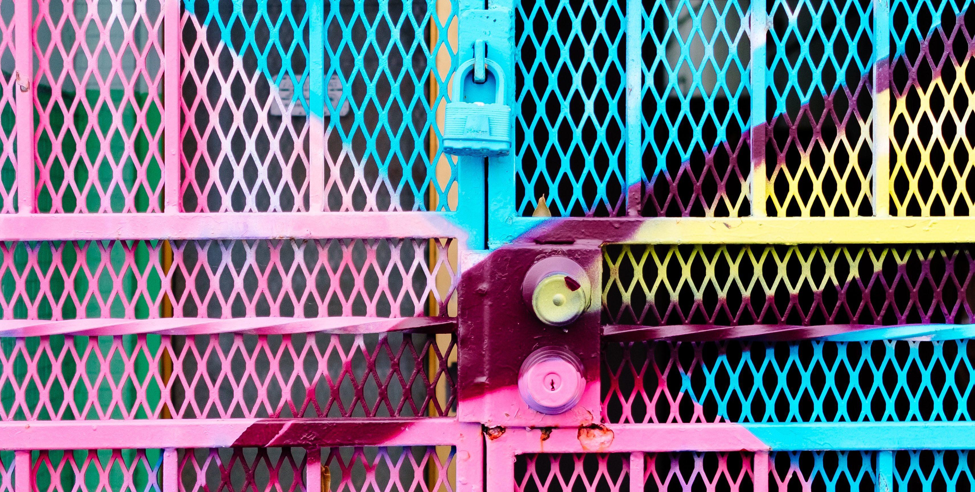 Colourful metal gate/door with padlocks