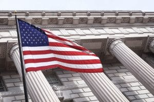 United States Flag in front of columns