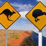 australia or new zealand kangaroo road sign next to kiwi road sign