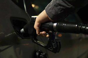 petrol pump inserted into car