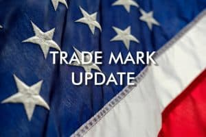 US flag background with TRADE MARK UPDATE text
