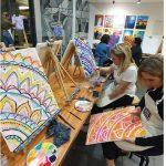 people painting in studio