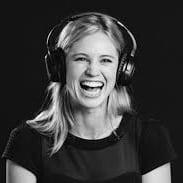 smiling lady wearing headphones
