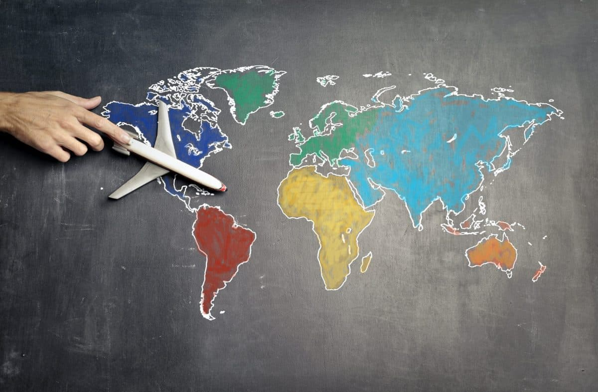 map of the world in coloured chalk on blackboard